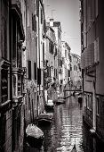 Old Houses With Moored Boats, Venice, Italy. Vertical View Of Narrow Street In Black And White. Vint poster