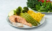 Healthy Food, Steamed Salmon, With Steamed Vegetables. Eggplant, Broccoli, Asparagus. poster