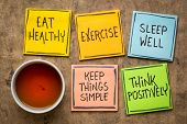 healthy lifestyle and wellbeing concept - a set of inspirational reminder notes with a cup of tea: e poster