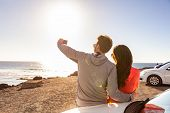Car road trip happy people tourists taking selfie at pit stop on adventure travel summer lifestyle.  poster