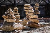 Close Up In A River Bed.stack Of Pebbles. Balancing On A River Background.rocks Stacked poster