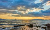 Beautiful sunset with colorful clouds over the sea - Panoramic sundown seascape - landscape poster