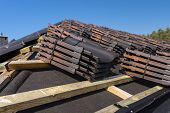 Roof Ceramic Tile Arranged In Packets On The Roof On Roof Battens. Preparation For Laying Roof Tiles poster