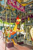 Colorful Horses And Cock In Vintage Carousel
