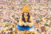 November Is Here. Child In Yellow Hat Outdoors. Hat Keep Warm. Kid Wear Warm Soft Knitted Hat. Warm  poster