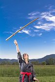 Woman ninja throwing sword
