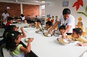 GUAYAQUIL, ECUADOR - FEBRUARY 8: Unknown children at lunch in the cafeteria after lessons by project