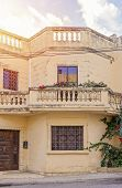 Fragment Of The Penthouse Against Blue Sky. Typical Mansions Of Malta. Authentic Residential Buildin poster