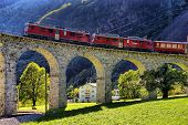 Swiss Mountain Train Bernina Express Passes The Spiral Of The Brusio Viaduct poster