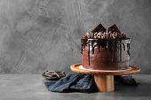 Freshly Made Delicious Chocolate Cake On Grey Table poster