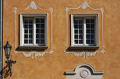 Windows With Decorations And Lanter On The Wall Of Renovated Old Tenement House In Gdansk Old Town,  poster