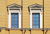stock photo of pilaster  - Pair windows decorated with portico and pilasters - JPG
