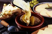 Raclette Cheese Melted Served In Individual Raclette Skillets poster