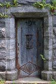 stock photo of burial-vault  - Metal mausoleum door with rust in a cemetery - JPG