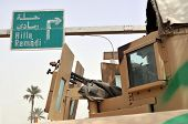 Fighting in Iraq. An armored vehicle in position next to a road leading to Hilla and Ramadi in central Iraq. A closeup showing the machine gun turret.