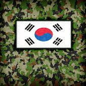 stock photo of ami  - Amy camouflage uniform with flag on it South Korea - JPG
