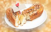 Delicious Breads With Sesame And Card Bank Paper And Hearts On The Clothesline On Bokeh Background