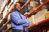 Portrait Of Businessman In Warehouse
