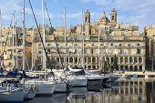 moored sailboats and waterfront of Senglea marina in front Vittoriosa, Malta