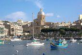 view on the bay of Kalkara Creek with St. Joseph Church, Malta