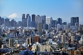 stock photo of mount fuji  - Skyscrapers in the Shinjuku Ward of Tokyo with Mt - JPG