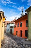 Medieval Paved Street In Sighisoara, Transylvania.
