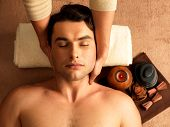 image of low-necked  - Masseur doing neck massage on man in the spa salon - JPG