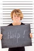 teen boy crying for help when in trouble with law