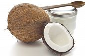 stock photo of flesh  - Coconut and organic coconut oil in a glass jar on white background - JPG