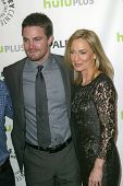 BEVERLY HILLS - MARCH 9: Stephen Amell and Susanna Thompson arrive at the 2013 Paleyfest
