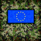 stock photo of ami  - Amy camouflage uniform with flag on it EU - JPG