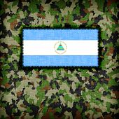 stock photo of ami  - Amy camouflage uniform with flag on it Nicaragua - JPG