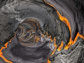 Conceptual 3D abstract perspective render of a futuristic curve tunnel or tube background with lava or fire