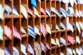 picture of going out business sale  - Rows of new colorful ties on shelves at shop. Great section of ties in different colors. Big choice of apparel or business style accessories ready for sale. Going shopping. Trade and commerce.