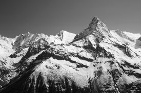 stock photo of grayscale  - The white tops of the mountains in summer black and white and grayscale images - JPG