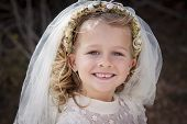 stock photo of communion  - A young child doing her first communion