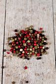 mixture of peppers on rustic wooden background