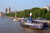 Party Boats Moored On The Embankment, London & Big Ben.