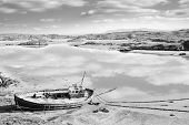Old Fishing Boat On Irish Beach In Black And White