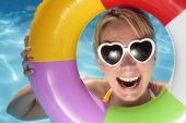 image of summer fun  - Laughing woman with sunglasses and inflatable toy - JPG
