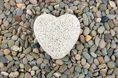 Heart on small sea stones, close up