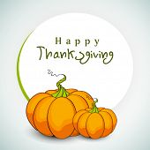 Happy Thanksgiving Day background with pumpkins and space for your message.
