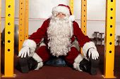 Santa Claus in fitness studio portrait