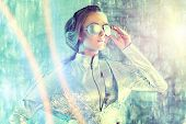 stock photo of latex woman  - Beautiful young woman in silver latex costume and glasses with futuristic hairstyle and make - JPG