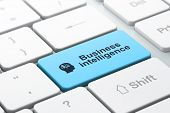 Business business concept: Head With Finance Symbol and Business Intelligence on computer keyboard b