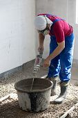 Worker prepare the mixture to pour the floor