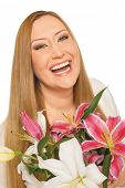 smiling xxl female holding flowers on white background