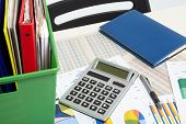 Calculator And Documents And Money On A Business Background