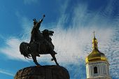 picture of hetman  - Bohdan Khmelnytsky monument and top of Sofia Cathedral on Sofia Square in Kiev - JPG