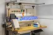 picture of workbench  - Technician workbench desk with tools and shelves - JPG
